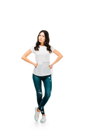 full length view of angry girl standing with hands on waist and looking at camera isolated on white