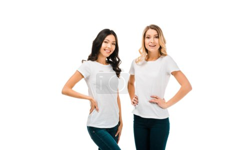 Photo for Beautiful happy girls in white t-shirts standing together and smiling at camera isolated on white - Royalty Free Image