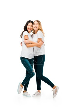 Photo for Full length view of beautiful happy young women hugging isolated on white - Royalty Free Image