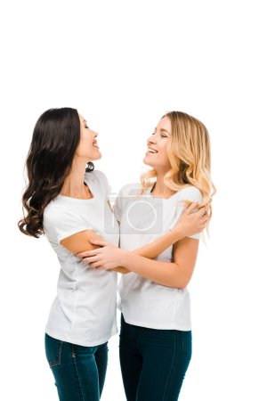 happy young women in white t-shirts hugging and smiling isolated on white