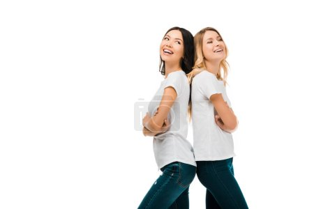 Photo for Side view of beautiful happy young women standing back to back and laughing isolated on white - Royalty Free Image