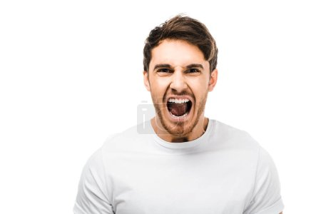 Photo for Emotional young man screaming and looking at camera isolated on white - Royalty Free Image