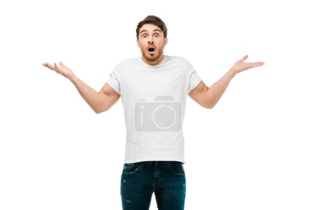 Photo for Shocked young man standing with open mouth and looking at camera isolated on white - Royalty Free Image