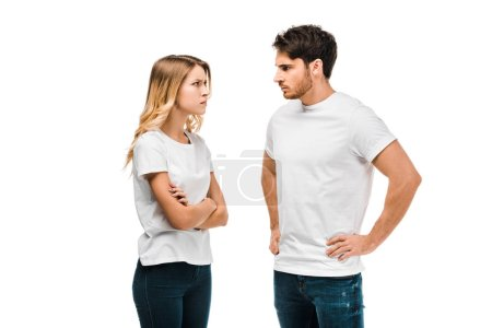 Photo for Upset young couple looking at each other isolate on white - Royalty Free Image