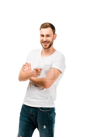 handsome happy man pointing with finger and smiling at camera isolated on white