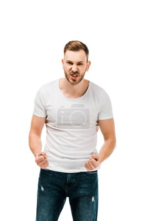 angry young man standing with clenched fists and looking at camera isolated on white