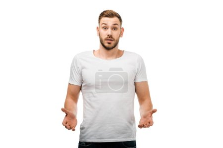 Photo for Confused young man gesturing with hands and looking at camera isolated on white - Royalty Free Image