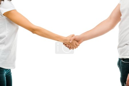 Photo for Cropped shot of young man and woman shaking hands isolated on white - Royalty Free Image