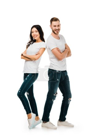 Photo for Happy young couple standing together with crossed arms and smiling at camera isolated on white - Royalty Free Image