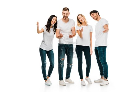 happy young men and women in white t-shirts gesturing with hands and smiling at camera isolated on white