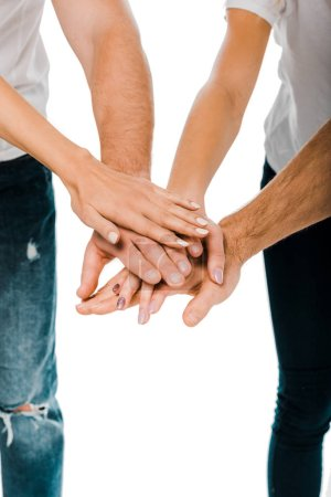 Photo for Close-up partial view of young friends stacking hands isolated on white - Royalty Free Image