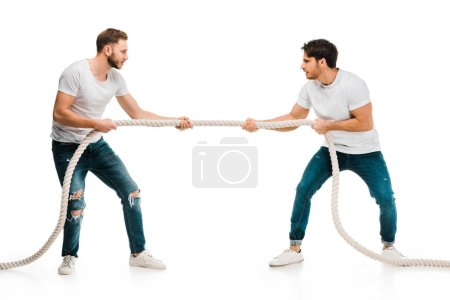 young men pulling rope and playing tug of war isolated on white