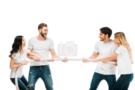 happy young couples pulling rope and playing tug of war isolated on white