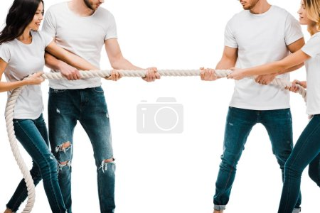 cropped shot of young couples pulling rope and playing tug of war isolated on white