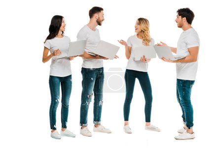 emotional young people using laptops and talking isolated on white