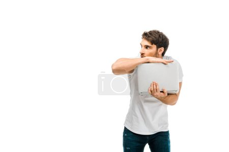 scared young man holding laptop and looking away isolated on white