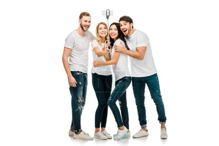 Photo for Happy young friends taking selfie with smartphone and selfie stick isolated on white - Royalty Free Image