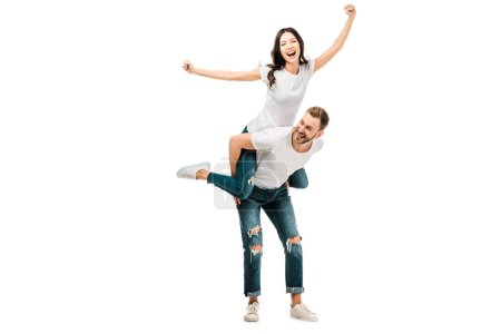 Photo for Cheerful young couple piggybacking and having fun together isolated on white - Royalty Free Image