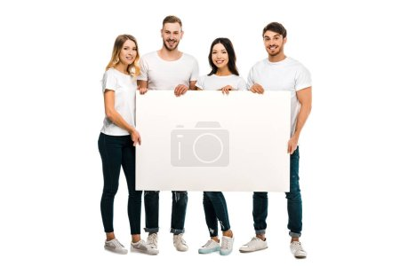 happy young people holding blank placard and smiling at camera isolated on white