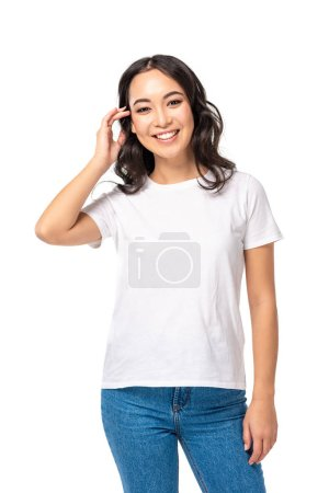 Photo for Pretty asian girl in t-shirt touching hair isolated on white - Royalty Free Image