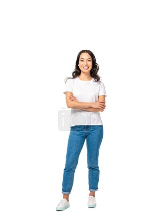 Photo for Smiling asian young woman in white t-shirt and blue jeans standing with crossed arms isolated on white - Royalty Free Image