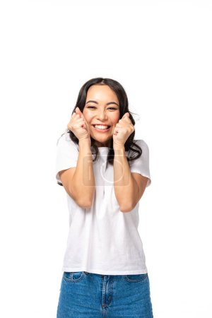 Photo for Smiling asian young woman holding hand fists near face isolated on white - Royalty Free Image