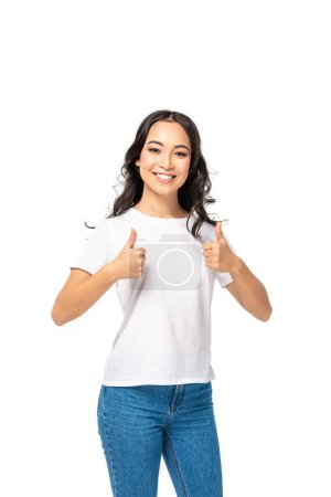 Photo for Smiling young asian woman showing thumbs up isolated on white - Royalty Free Image