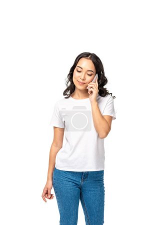 Photo for Pretty sian girl with closed eyes in white t-shirt and blue jeans talking on smartphone isolated on white - Royalty Free Image