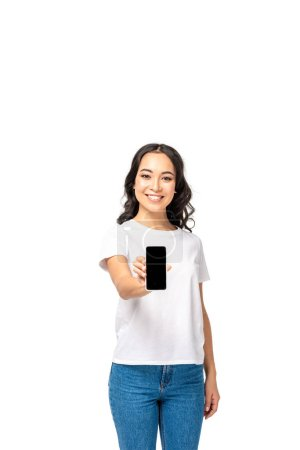 Photo for Beautiful young asian girl showing smartphone with blank screen isolated on white - Royalty Free Image
