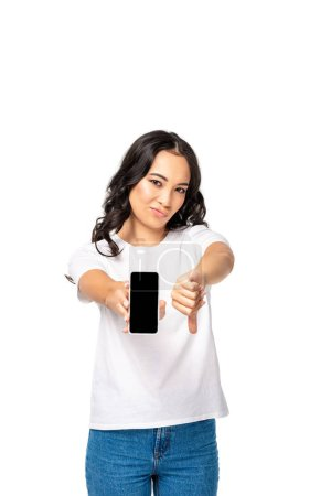 Photo for Dissatisfied asian woman holding smartphone with blank screen and showing thumb down isolated on white - Royalty Free Image