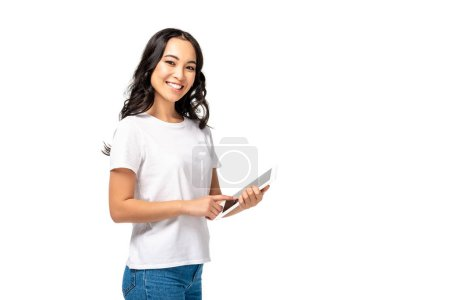 Photo for Smiling asian using digital tablet while looking at camera isolated on white - Royalty Free Image