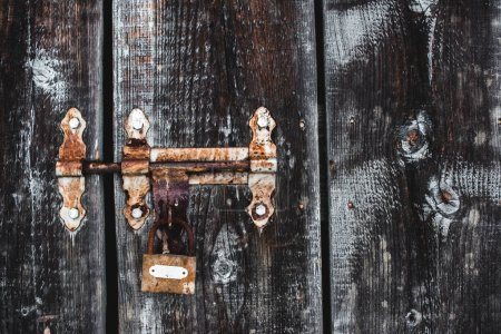 Photo for Old weathered rusty lock on wooden frosty door - Royalty Free Image