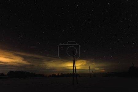 Photo for Dark sky with yellow illumination in carpathian mountains at night - Royalty Free Image
