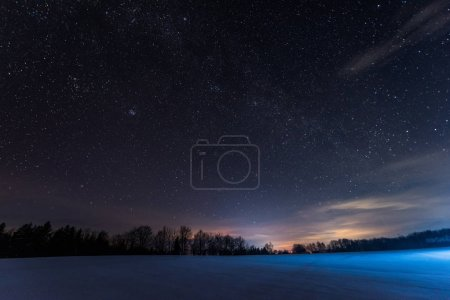 Photo for Dark sky full of shiny stars in carpathian mountains in winter at night - Royalty Free Image