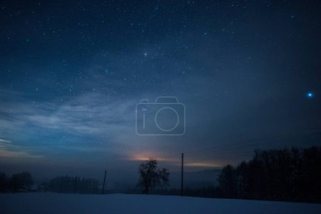 Photo for Starry dark sky in carpathian mountains at night in winter - Royalty Free Image