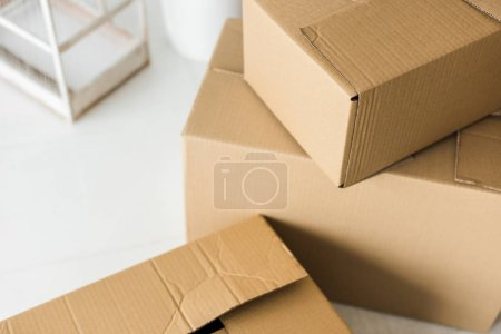 Photo for Brown cardboard boxes on light surface at home - Royalty Free Image