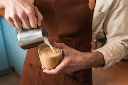 Photo for Cropped view of barista pouring milk in coffee - Royalty Free Image