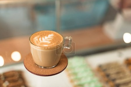Photo for Cup of coffee with latte art of glass surface - Royalty Free Image