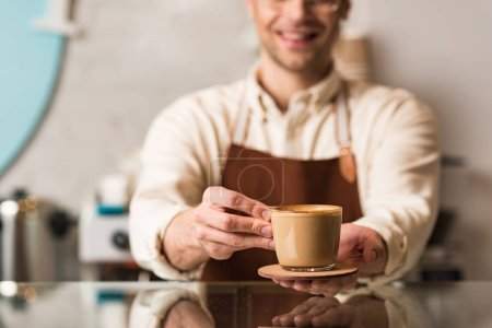 Photo for Selective focus of barista holding cup of coffee - Royalty Free Image