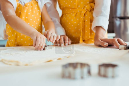 Photo for Selective focus of mother and daughter using dough molds on dough - Royalty Free Image