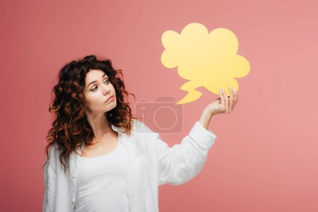Photo for Beautiful curly girl with red hair holding yellow thought bubble on pink - Royalty Free Image