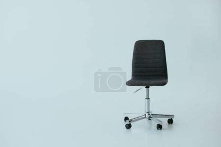 Photo for Luxury black leather office chair on grey with copy space - Royalty Free Image