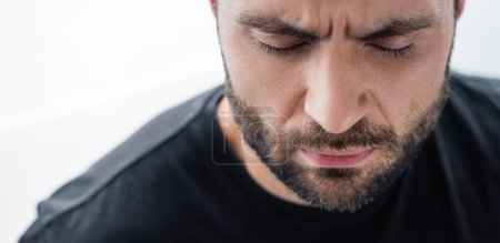 Photo for Panoramic shot of depressed bearded man with closed eyes - Royalty Free Image