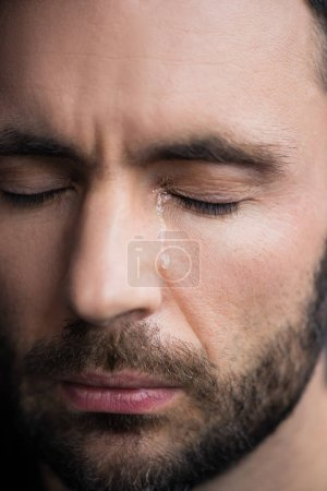 Photo for Portrait of handsome depressed man crying with closed eyes - Royalty Free Image