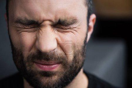 Foto de Portrait of depressed bearded man crying with closed eyes - Imagen libre de derechos