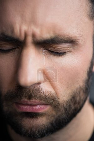 Photo for Portrait of handsome, bearded depressed man crying with closed eyes - Royalty Free Image