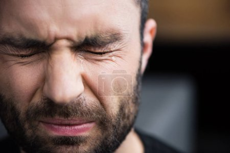 Photo for Portrait of handsome bearded man crying with closed eyes with tears on face - Royalty Free Image