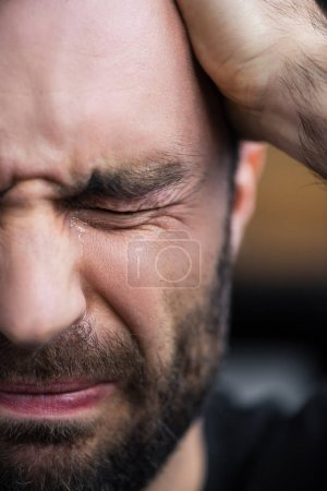 Photo for Partial view of depressed bearded man crying with closed eyes - Royalty Free Image