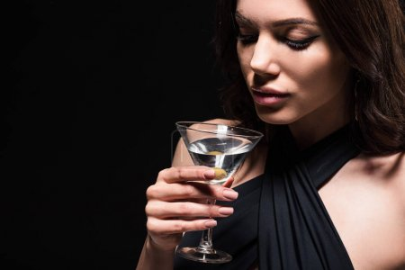Photo for Pretty woman with makeup holding glass of martini with olive isolated on black - Royalty Free Image