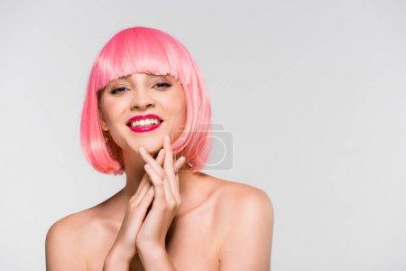 Foto de Attractive naked young woman in pink wig isolated on grey - Imagen libre de derechos